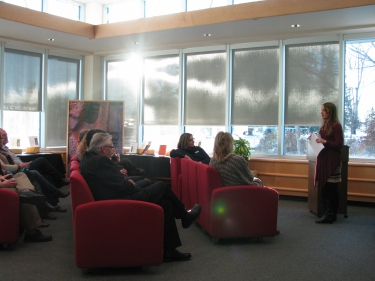 Chelsey Reid, Copyright Officer, introduces speakers at the MHC IP Exhibit in the Southwest Lounge, Vera Bracken Library.